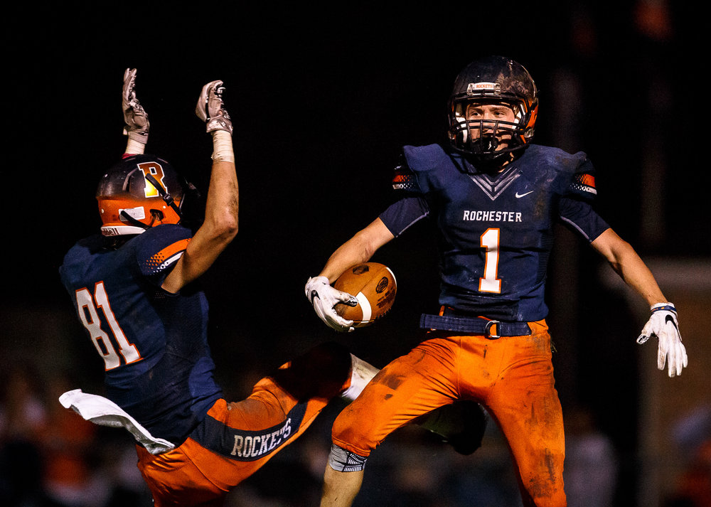 Rochester's Riley Lewis (1) celebrates his touchdown with Rochester's Jayden Reed (81) against Sacred Heart-Griffin in the third quarter at Rocket Booster Stadium, Friday, Oct. 6, 2017, in Rochester, Ill. [Justin L. Fowler/The State Journal-Register]