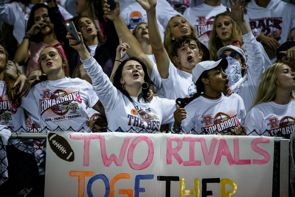 The Rochester student section sings in unison as the Rockets take on Sacred Heart-Griffin in the third quarter at Rocket Booster Stadium, Friday, Oct. 6, 2017, in Rochester, Ill. [Justin L. Fowler/The State Journal-Register]