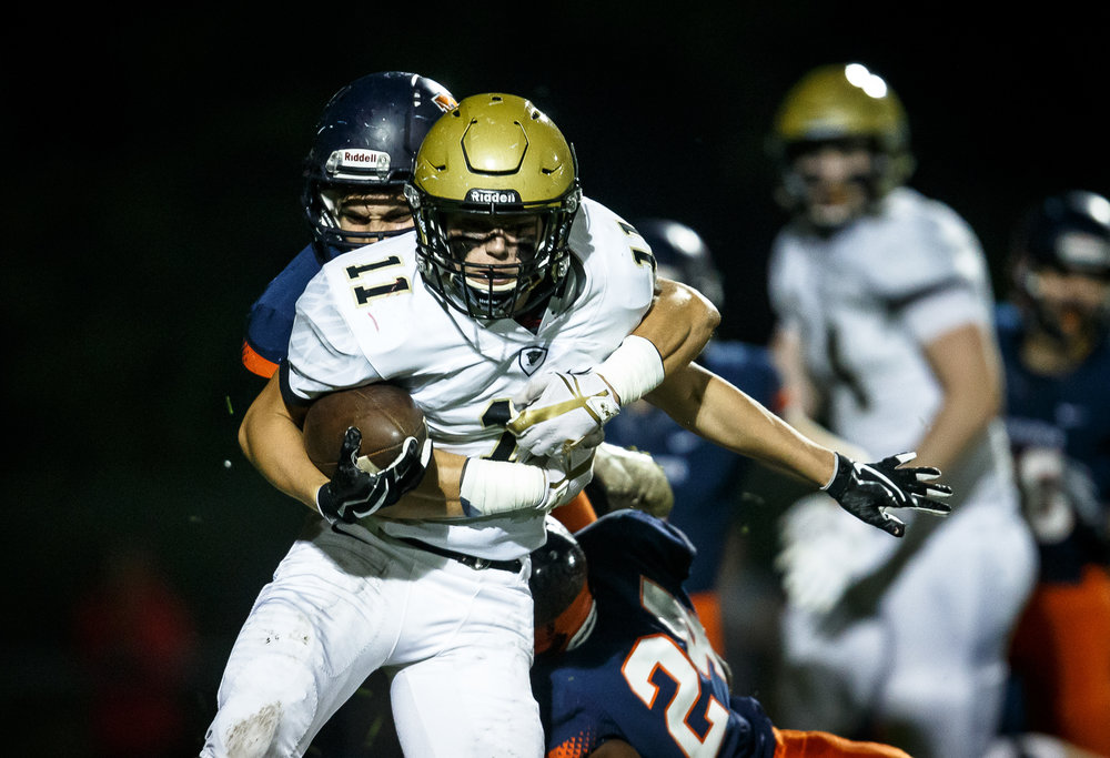 Sacred Heart-Griffin's Cade Holaway (11) is brought down by Rochester's Stephan McCree (15) on a kickoff return in the first quarter at Rocket Booster Stadium, Friday, Oct. 6, 2017, in Rochester, Ill. [Justin L. Fowler/The State Journal-Register]