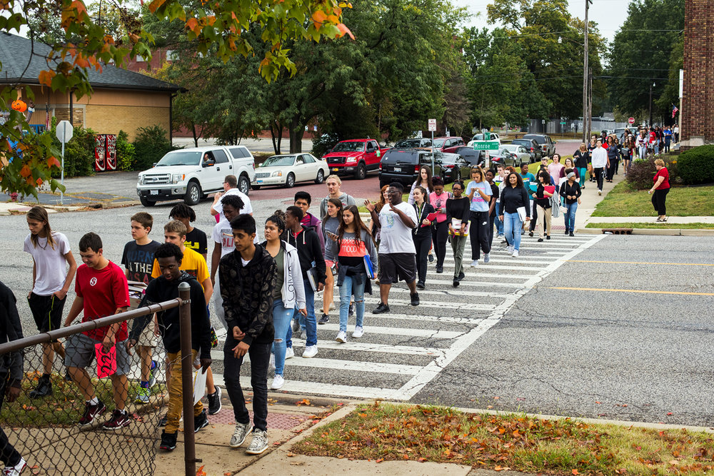 Springfield High School students cross Monroe Street as they head back to classes after being evacuated following threatening phone calls made to all three high schools and Franklin Middle School Thursday, Oct. 5, 2017. [Ted Schurter/The State Journal-Register]