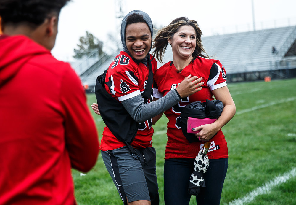 Springfield High School junior Qaron Hawkins shows his excitement after meeting Brittany Wagner, a motivational speaker and star of the Netflix documentary Last Chance U, at Memorial Stadium, Saturday, Oct. 7, 2017, in Springfield, Ill. Wagner spoke to the Senators football team prior their game and used the now infamous line of ÒDo you have a pencil?Ó from the documentary as a lesson on being prepared and to not only learn from mistakes, but how to move on in life afterwards. [Justin L. Fowler/The State Journal-Register]