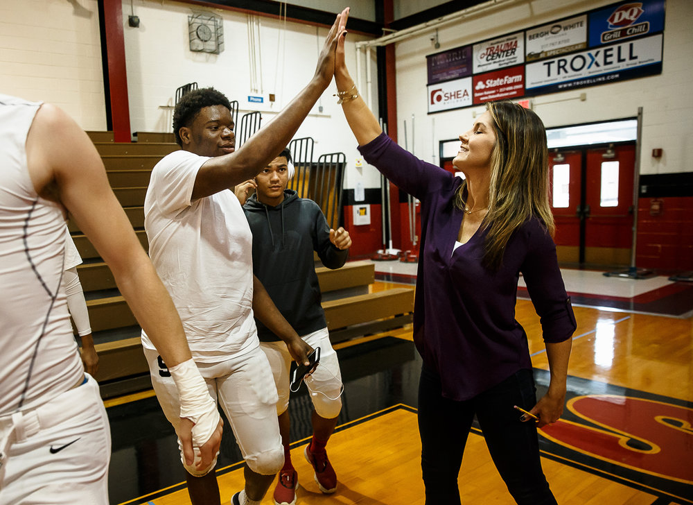 Springfield High School senior Larry Williams, left, gets a high five from Brittany Wagner, a motivational speaker and star of the Netflix documentary Last Chance U, after she delivered a speech of overcoming adversity in life to the Springfield High School varsity football team inside the gymnasium at Springfield High School, Saturday, Oct. 7, 2017, in Springfield, Ill. Wagner used the now infamous line of ÒDo you have a pencil?Ó from the documentary as a lesson on being prepared and to not only learn from mistakes, but how to move on in life afterwards. [Justin L. Fowler/The State Journal-Register]