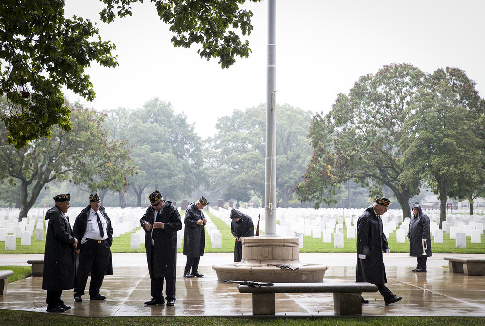 With a light rain falling, the Sangamon County Interveterans Burial Detail Honor Guard prepares for a ceremony Wednesday at Camp Butler National Cemetery where ten unaccompanied veterans were given a funeral with full military honors. The recently interred veterans, who either had no relatives or no relatives who could travel to the cemetery at the time of burial, were honored with the presentation of colors, a ceremonial flag folding, a rifle volley and the playing of taps. The ceremony is held twice each year. [Rich Saal/The State Journal-Register]
