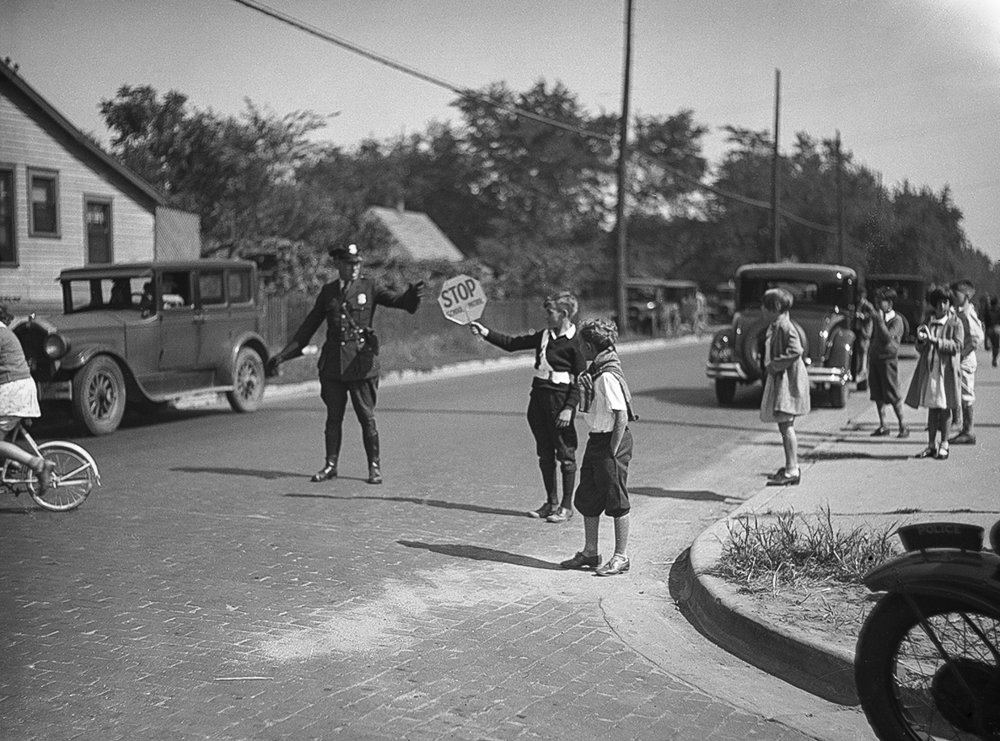 Traffic officer Lee Pfund is assisted by Tom O'Shea on Laurel Street in front of Blessed Sacrament school, Oct. 1, 1930. File/The State Journal-Register