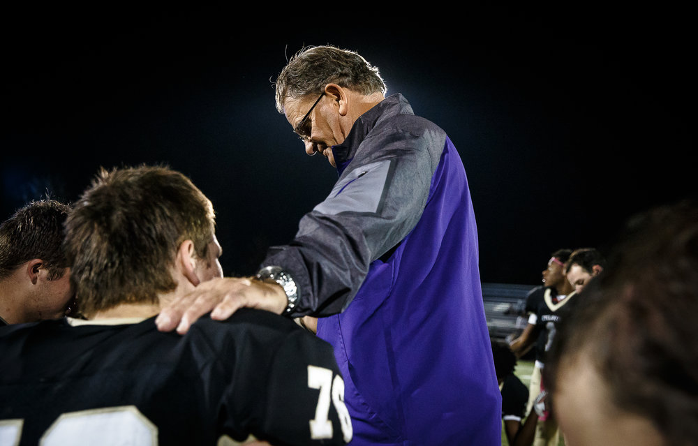 Scared Heart-Griffin head football coach Ken Leonard prays with his players after SHG defeated Springfield 49-7 at Ken Leonard Field, Friday, Oct. 13, 2017, in Springfield, Ill. [Justin L. Fowler/The State Journal-Register]