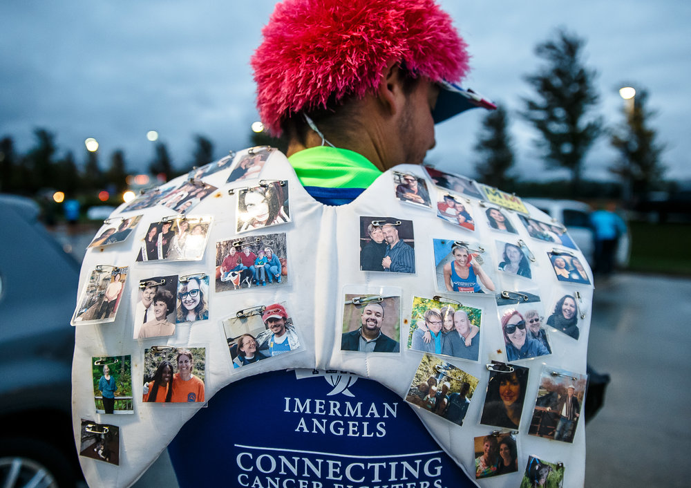 "Stephen ""Sven"" Johnson gets set to run the marathon distance as a part of Team Imeran Angels with ""wings"" on his back with images of people in his life that have dealt with cancer during the 5th annual Springfield Clinic Springfield Marathon at the University of Illinois Springfield, Sunday, Oct. 15, 2017, in Springfield, Ill. ""If you're out in the community you know and learn about a lot of people with cancer,"" said Johnson. ""The people on my back are people that have been in my life that have faced cancer or haven't it made it through."" Imeran Angels matches up cancer fighters with cancer survivors and caregivers with one-on-one support. [Justin L. Fowler/The State Journal-Register]"
