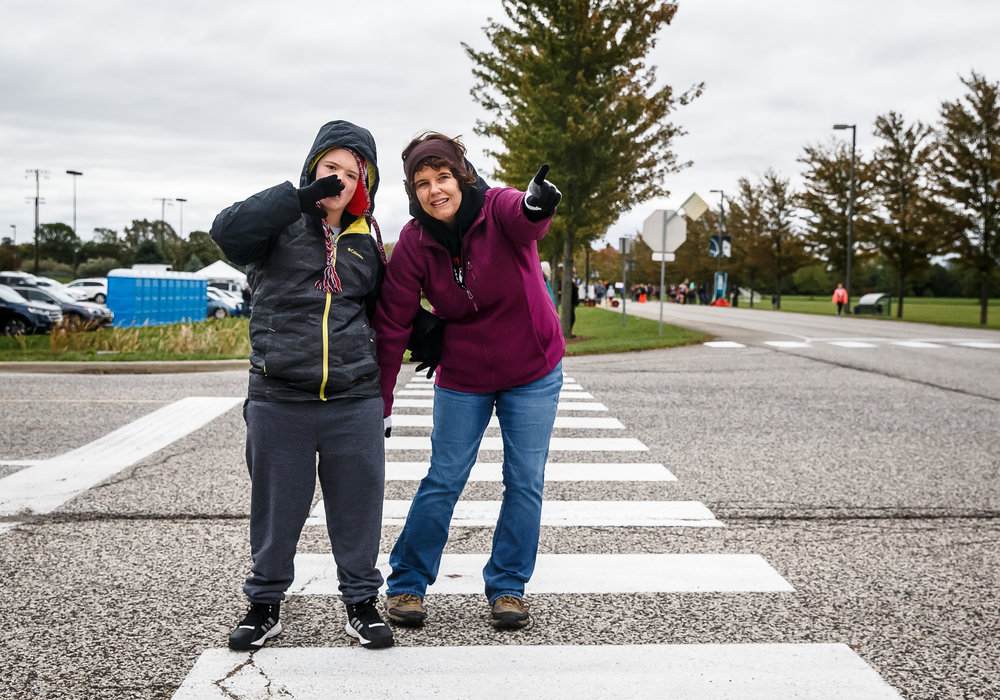 Deb Gossrow and her son Joshua Gossrow, 11, prepare to cheer on  Andrew Gossrow, her husband and Joshua's father, as he nears the the finish line during the 5th annual Springfield Clinic Springfield Marathon at the University of Illinois Springfield, Sunday, Oct. 15, 2017, in Springfield, Ill. The event includes distances of 3/4 marathon, half marathon, quarter marathon and a marathon relay. [Justin L. Fowler/The State Journal-Register]
