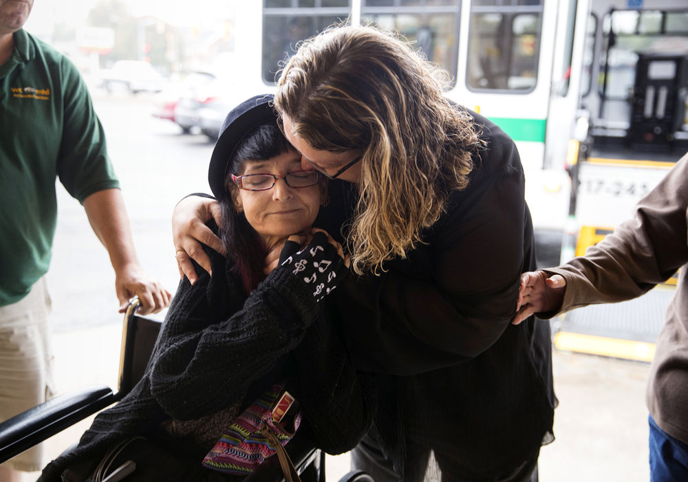 Megan Rhoades is embraced by her best friend of 35 years, Mary Rogers, after arriving at Magna Dental in Springfield to receive dentures from Dr. Keith Cummins. Cummins, an old colleague of Rhoades, pulled 24 of her teeth and fitted her dentures free of charge after complications from an auto-immune disease and a fall threatened her already fragile health. [Ted Schurter/The State Journal-Register]