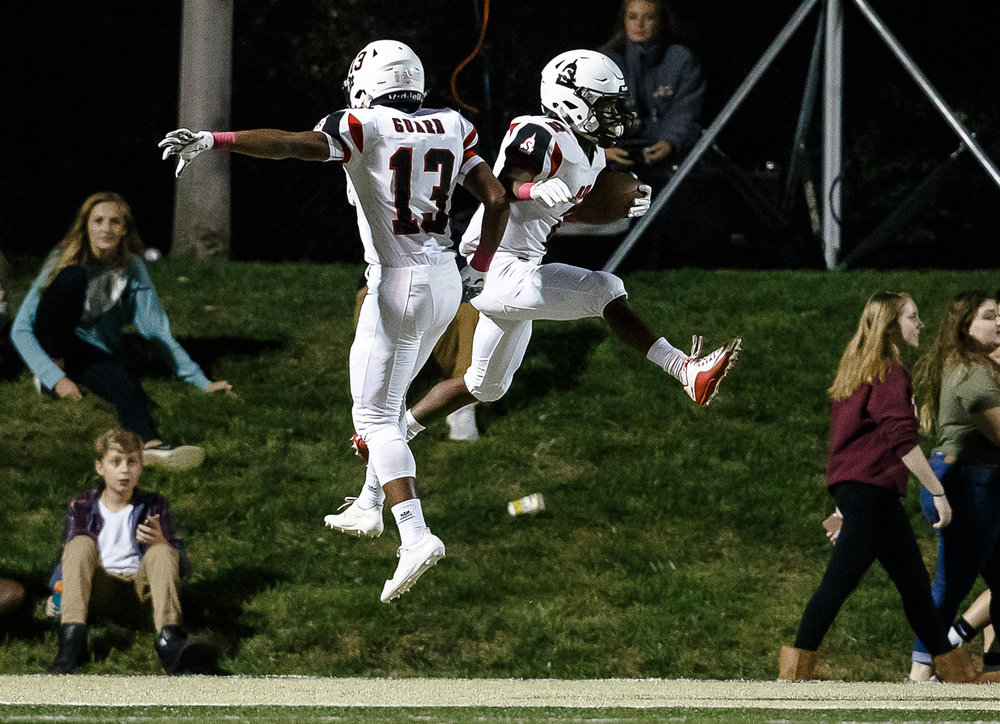 Springfield's John Waddy (2) celebrates his 44-yard touchdown catch with Springfield's Kenny Guard (13) against Sacred Heart-Griffin in the first half at Ken Leonard Field, Friday, Oct. 13, 2017, in Springfield, Ill. [Justin L. Fowler/The State Journal-Register]