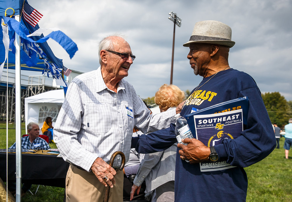 "John Thompson, right, a member of the first graduating class of Southeast High School in 1968, visits with his former history teacher, Bob Kyes, left, during Southeast's 50th Anniversary Celebration at Southeast High Schools, Saturday, Oct. 14, 2017, in Springfield, Ill. ""When I think of myself in school I think of him as well,"" said Thompson. ""He was such a big part of that and made an indelible impression on me as teachers often do, the ones that really show you love."" [Justin L. Fowler/The State Journal-Register]"