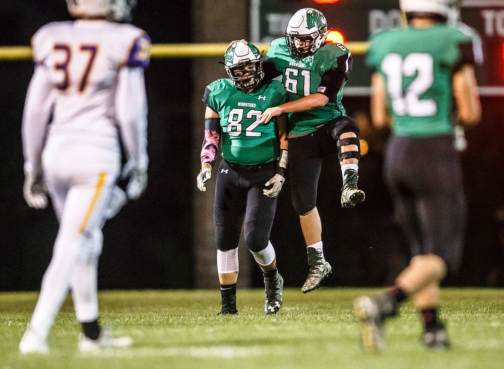 Athens' Sam Heffernan (61) and Athens' Noah Tisdale (82) celebrate a defensive stop against Williamsville in the first quarter at Athens High School, Friday, Oct. 20, 2017, in Athens, Ill. [Justin L. Fowler/The State Journal-Register]