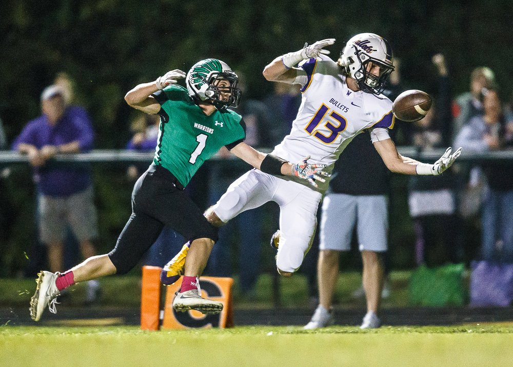 Williamsville's Joseph Mitchell (13) is unable to make a catch in the end zone against Athens' Dylan Fletcher (1) in the first quarter at Athens High School, Friday, Oct. 20, 2017, in Athens, Ill. [Justin L. Fowler/The State Journal-Register]