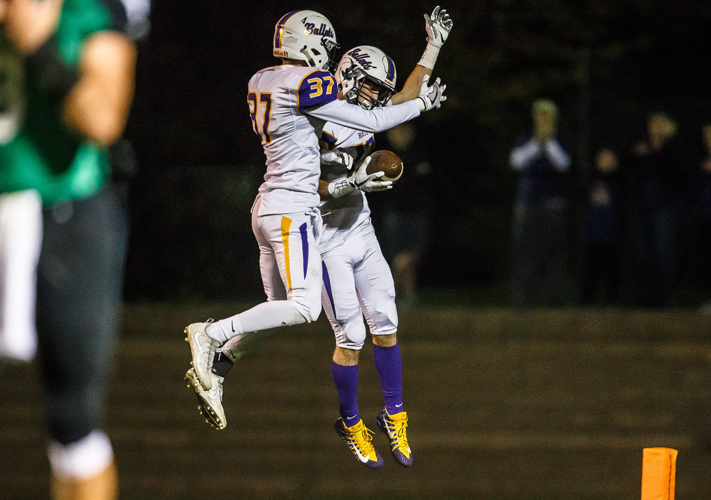Williamsville's Joseph Mitchell (13) celebrates his touchdown with Williamsville's TJ Ater (37) against Athens in the first quarter at Athens High School, Friday, Oct. 20, 2017, in Athens, Ill. [Justin L. Fowler/The State Journal-Register]