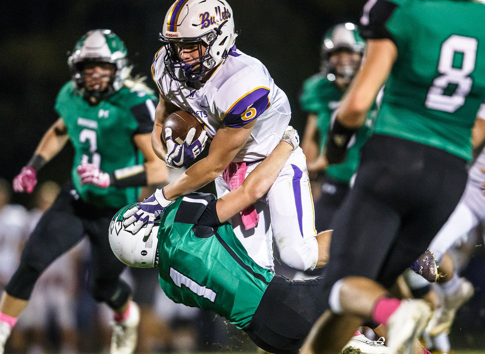 Williamsville's Grant Ripperda (6) is brought down by Athens' Dylan Fletcher (1) on a rush in the second quarter at Athens High School, Friday, Oct. 20, 2017, in Athens, Ill. [Justin L. Fowler/The State Journal-Register]