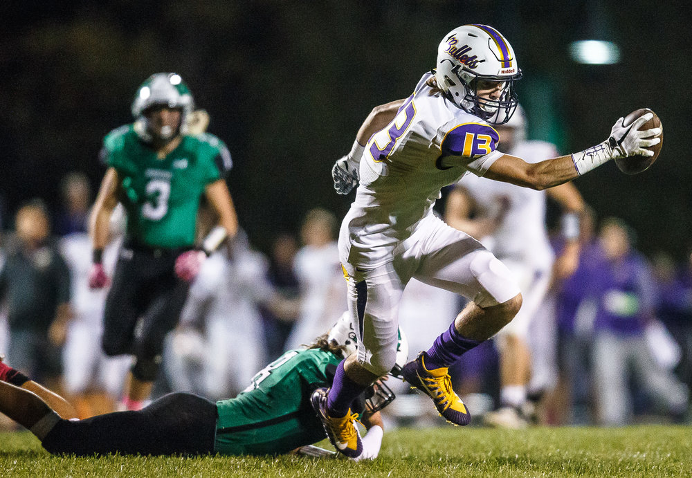 Williamsville's Joseph Mitchell (13) spins out of a tackle from Athens' Mason Reiff (8) after a catch in the second quarter at Athens High School, Friday, Oct. 20, 2017, in Athens, Ill. [Justin L. Fowler/The State Journal-Register]