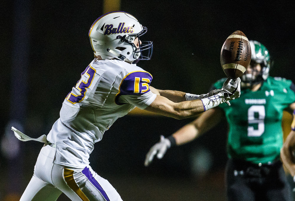 Williamsville's Joseph Mitchell (13) pulls in a pass on his fingertips for a catch against Athens in the third quarter at Athens High School, Friday, Oct. 20, 2017, in Athens, Ill. [Justin L. Fowler/The State Journal-Register]