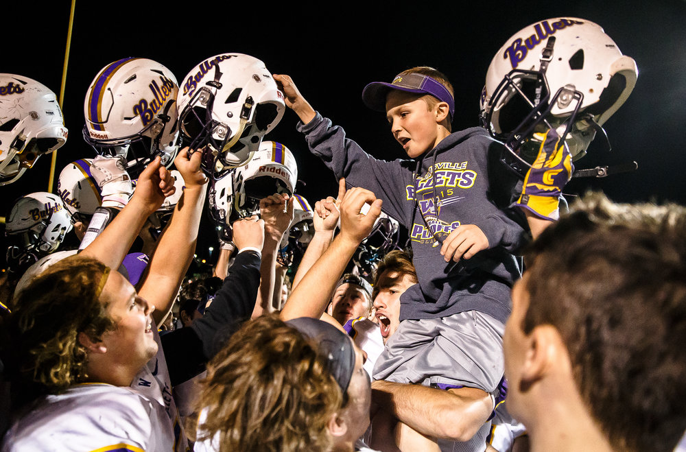 Seth Kunz, the son of Williamsville head football coach Aaron Kunz, is hoisted up by the players as they celebrate going undefeated in the regular season with a 28-0 victory over Athens at Athens High School, Friday, Oct. 20, 2017, in Athens, Ill. [Justin L. Fowler/The State Journal-Register]