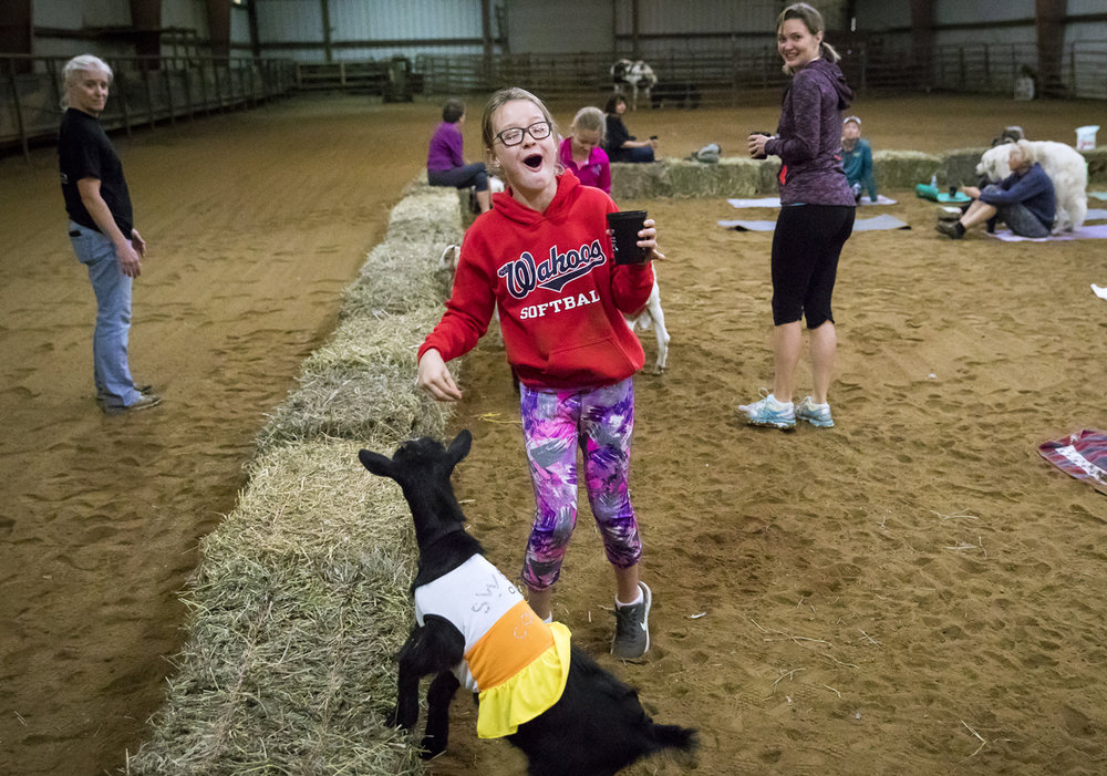 Mia Volpert reacts after a goat ate from her hand prior to a yoga class with goats Sunday, Oct. 22, 2017 at Willow City Farm near Cantrall. [Rich Saal/The State Journal-Register]