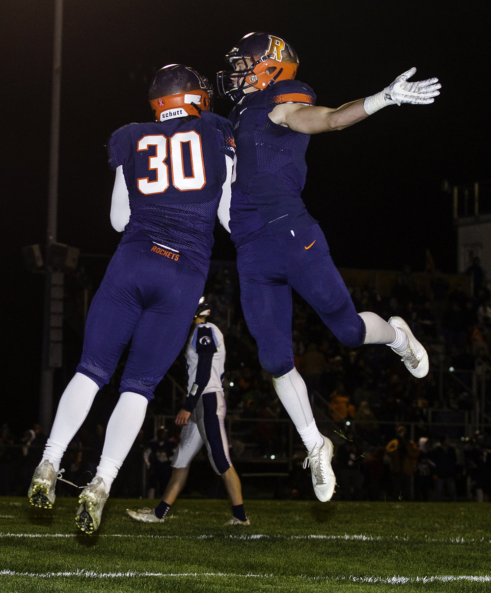 Rochester's Zach Gleeson, left, and Rochester's Cade Eddington celebrate Gleeson's second quarter touchdown at Rochester High School Friday, Oct. 27, 2017. [Ted Schurter/The State Journal-Register]