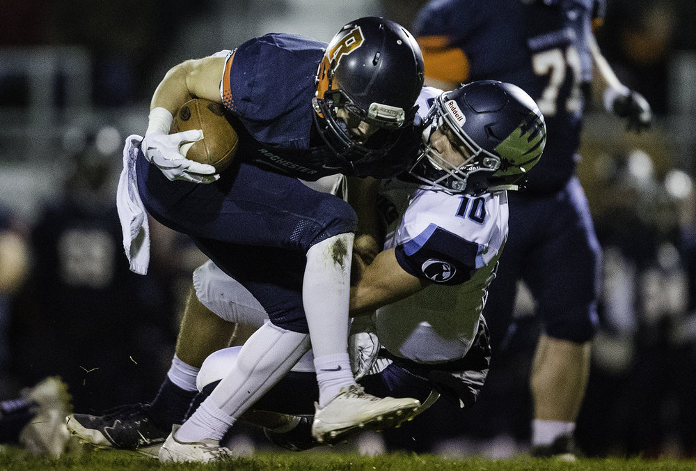Rochester's Cade Eddington plows into Prairie Central's Ty Zimmerman in the first half at Rochester High School Friday, Oct. 27, 2017. [Ted Schurter/The State Journal-Register]