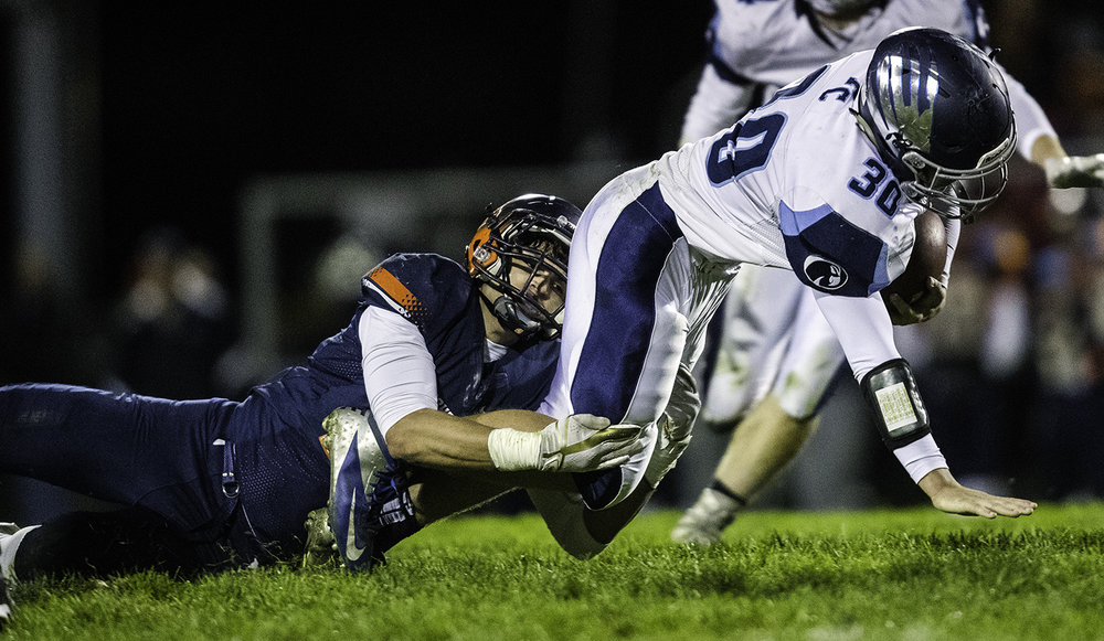 Rochester's Stephan McCree brings down Prairie Central's Matt Kerns at Rochester High School Friday, Oct. 27, 2017. [Ted Schurter/The State Journal-Register]