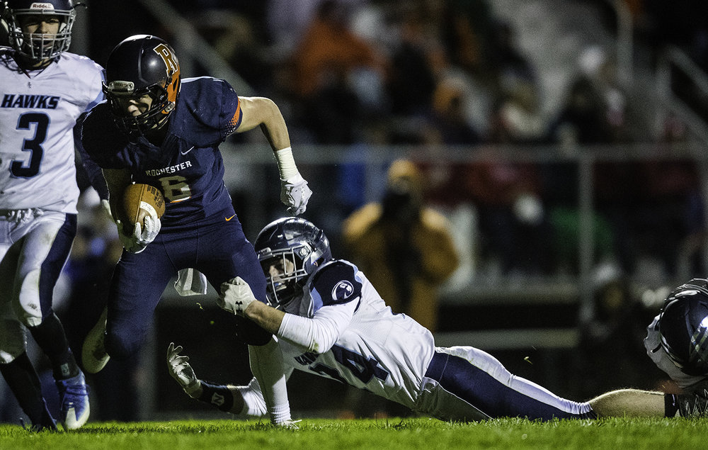 Rochester's Cade Eddington breaks a tackle from Prairie Central's Austin Burton on his way to the endzone in the first half at Rochester High School Friday, Oct. 27, 2017. [Ted Schurter/The State Journal-Register]