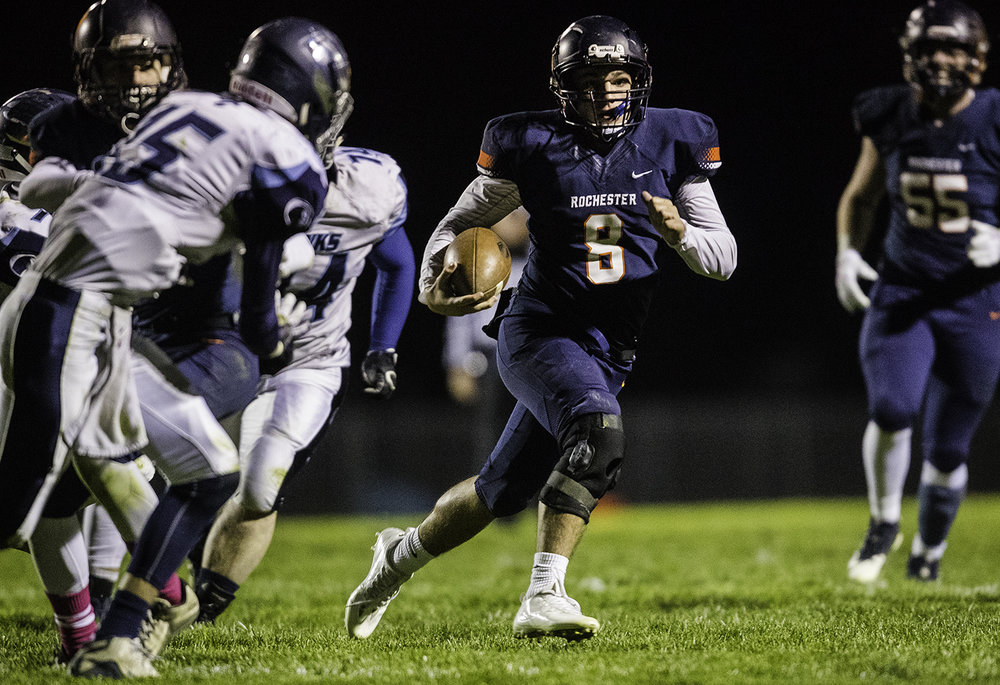 Rochester's Nic Baker rushes for a third quarter touchdown at Rochester High School Friday, Oct. 27, 2017. [Ted Schurter/The State Journal-Register]