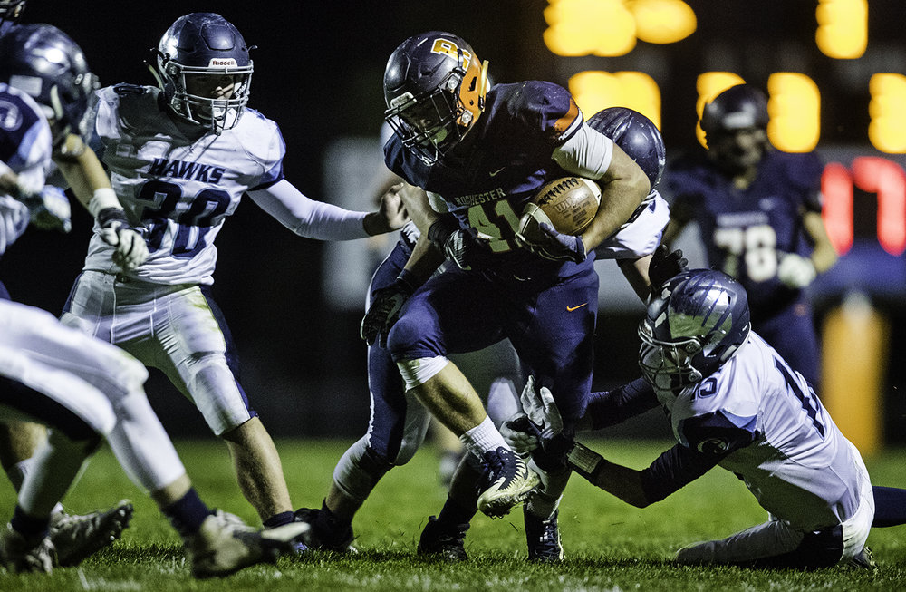 Rochester's Nick Capriotti plows through Prairie Central defense at Rochester High School Friday, Oct. 27, 2017. [Ted Schurter/The State Journal-Register]