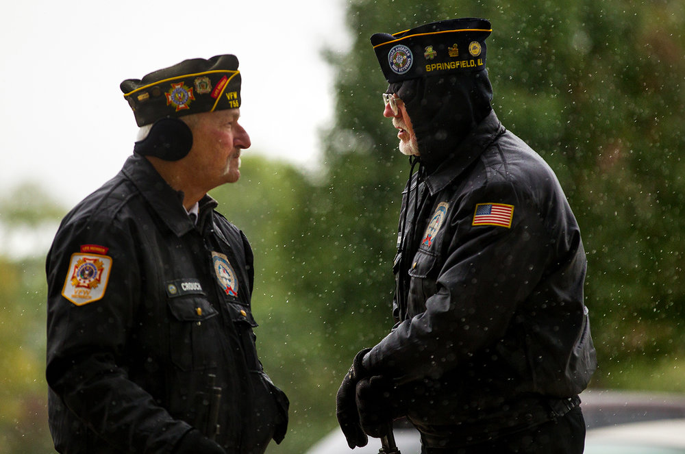 Sangamon County Interveterans Burial Detail members wait out a brief snow flurry before the funeral for Army Staff Sgt. Michael Aiello to his niece Rose Carlson at  Camp Butler National Cemetery Saturday, Oct. 28, 2017. [Ted Schurter/The State Journal-Register]