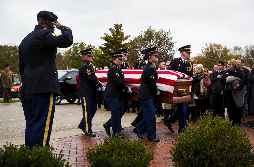 Members of the Illinois Army National Guard Military Funeral Honor Guard carry the casket of Army Staff Sgt. Michael Aiello before his funeral service at Camp Butler National Cemetery Saturday, Oct. 28, 2017. Military records indicated Aiello went missing Sept. 30 1944, during intense fighting near the bridge at Nijmegen  in the Netherlands. About eight years ago, the military disinterred a set of remains that were later identified as Aiello. His remains were returned this week. [Ted Schurter/The State Journal-Register]
