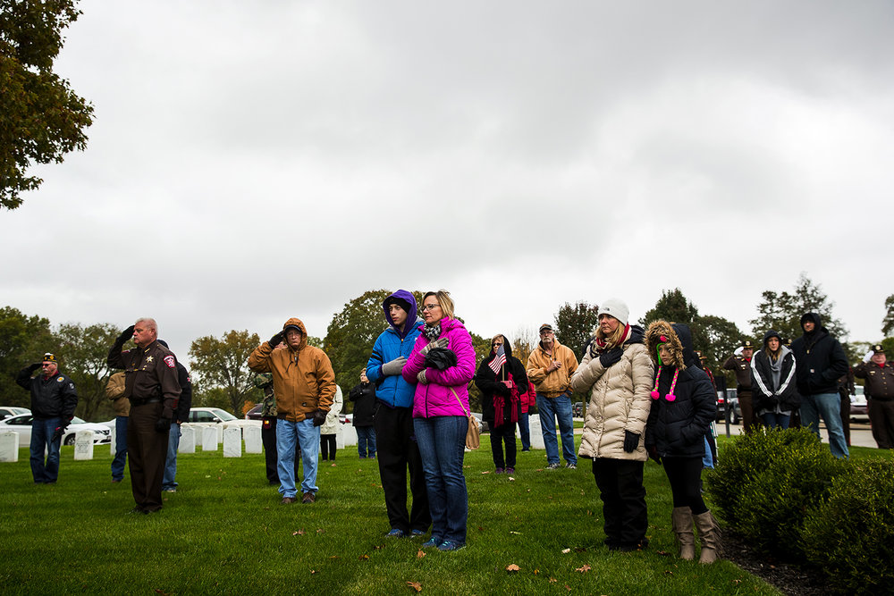 Mourners watch as members of the Illinois Army National Guard Military Funeral Honor Guard carry the casket of Army Staff Sgt. Michael Aiello at Camp Butler National Cemetery Saturday, Oct. 28, 2017. Military records indicated Aiello went missing Sept. 30 1944, during intense fighting near the bridge at Nijmegen  in the Netherlands. About eight years ago, the military disinterred a set of remains that were later identified as Aiello. His remains were returned this week. [Ted Schurter/The State Journal-Register]
