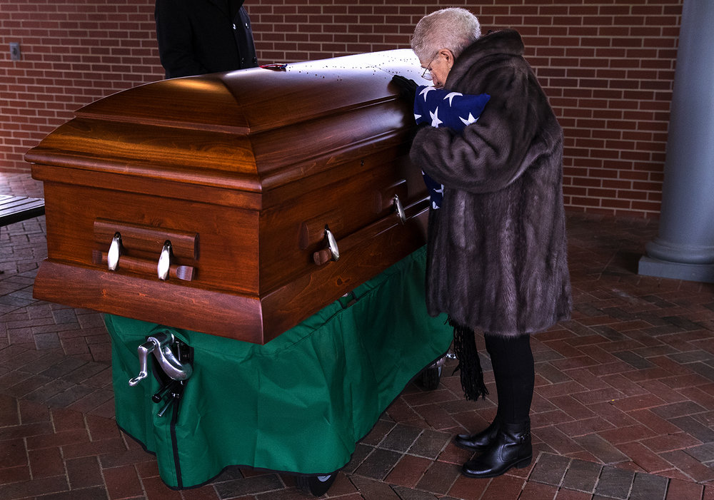 Rose Aiello Palazzolo pauses at the casket of her uncle, Army Staff Sgt. Michael Aiello, before leaving the burial service at Camp Butler National Cemetery Saturday, Oct. 28, 2017. Military records indicated Aiello went missing Sept. 30 1944, during intense fighting near the bridge at Nijmegen in the Netherlands. About eight years ago, the military disinterred a set of remains that were later identified as Aiello. His remains were returned to Springfield, Ill., this week. [Ted Schurter/The State Journal-Register]