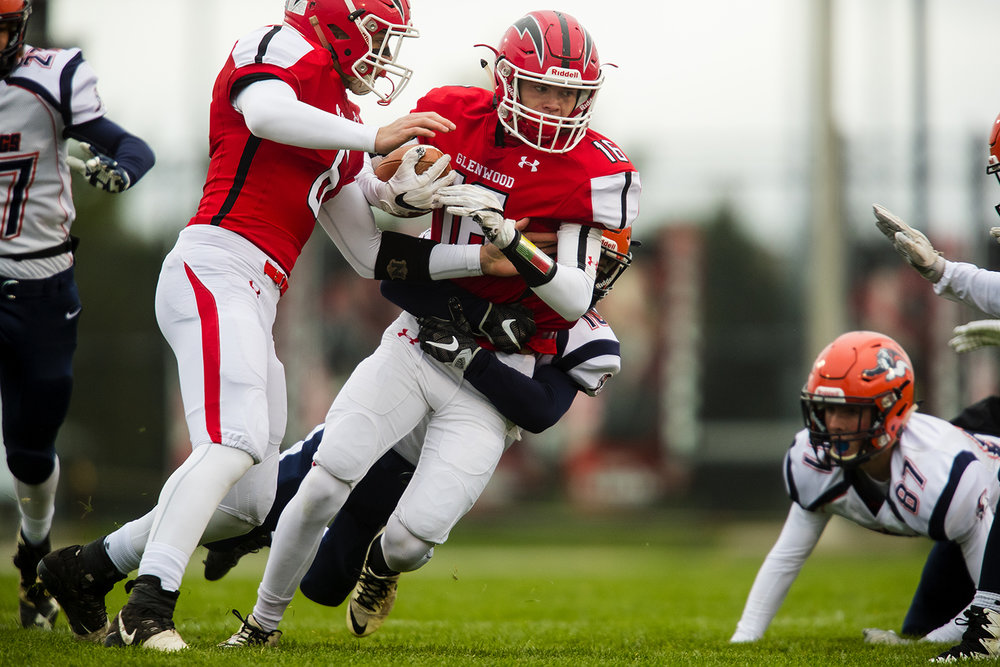Glenwood's Drew Dunbar is wrapped up by a Mahomet-Seymour defender after a run during the IHSA Class 5A football playoffs at Chatham Glenwood Saturday, Oct. 28, 2017. [Ted Schurter/The State Journal-Register]