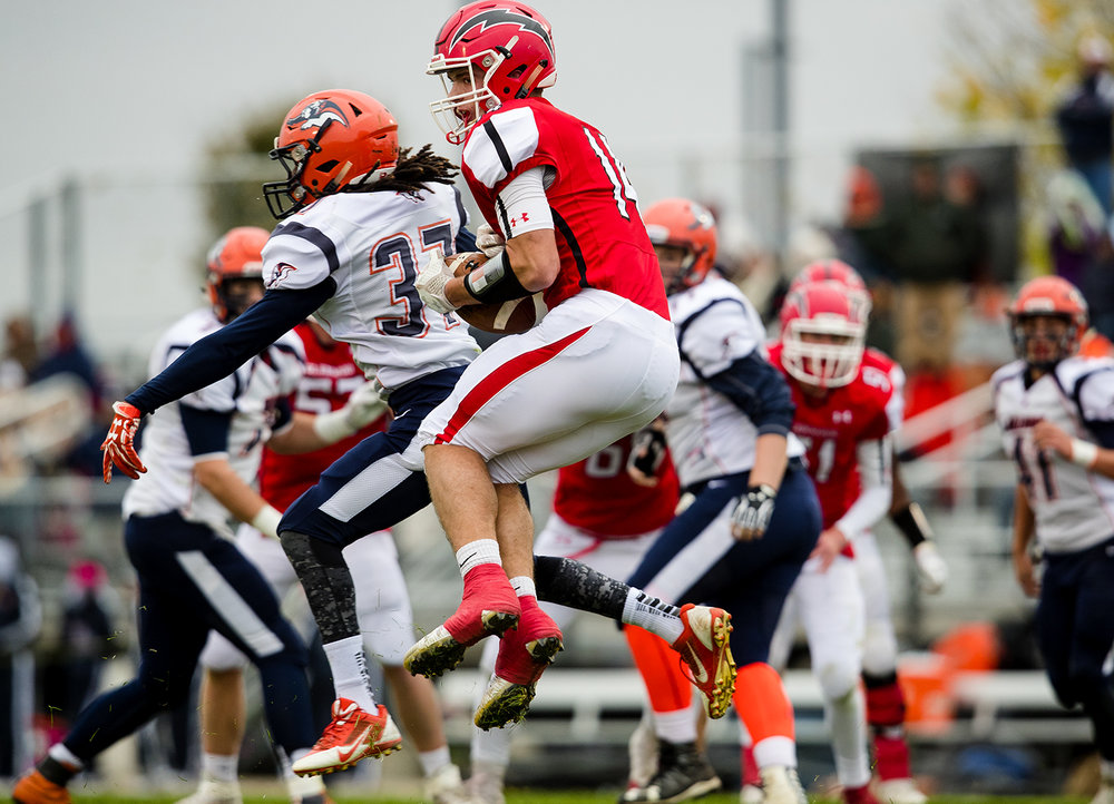 Glenwood's Cole Hembrough grabs a pass in front of Mahomet-Seymour's Daunte Roberts during the IHSA Class 5A football playoffs at Chatham Glenwood Saturday, Oct. 28, 2017. [Ted Schurter/The State Journal-Register]