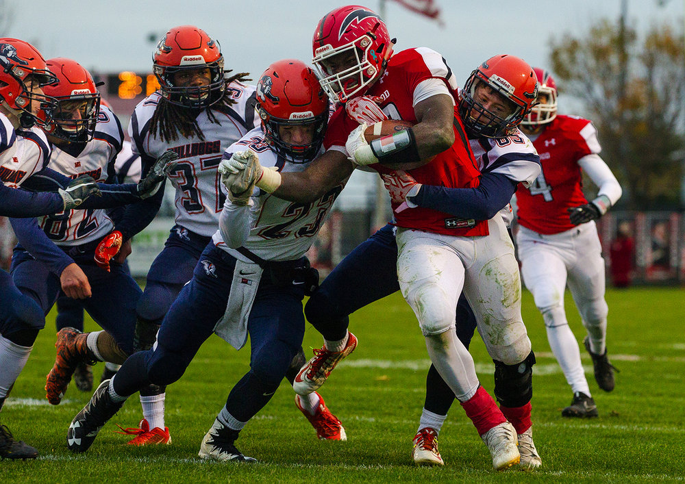 Mahomet-Seymour defenders try to bring Glenwood's Jubbar Cross down in the fourth quarter during the IHSA Class 5A football playoffs at Chatham Glenwood Saturday, Oct. 28, 2017. [Ted Schurter/The State Journal-Register]