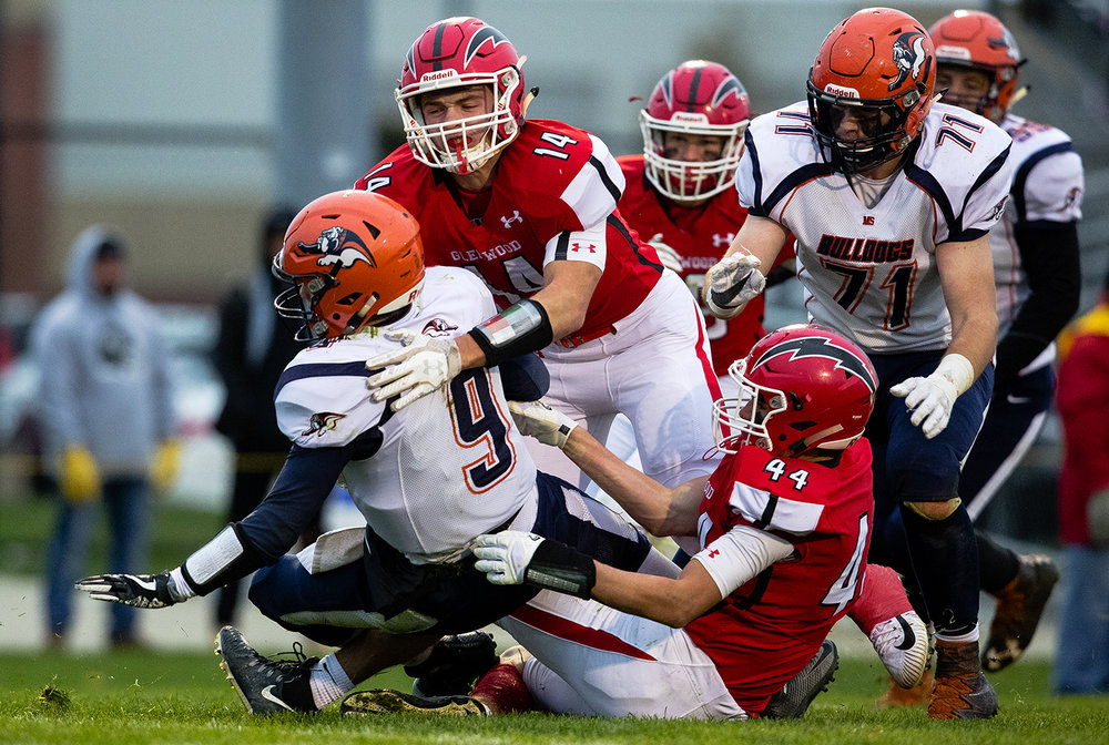 Glenwood's Cole Hembrough, left, and Tyler Burris sack Mahomet-Seymour's Dawson Finch in the fourth quarter during the IHSA Class 5A football playoffs at Chatham Glenwood Saturday, Oct. 28, 2017. [Ted Schurter/The State Journal-Register]