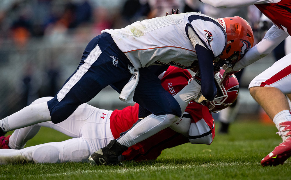 Glenwood's Jaylon Cal forces a fumble from Mahomet-Seymour's Josh Johnson in the fourth quarter during the IHSA Class 5A football playoffs at Chatham Glenwood Saturday, Oct. 28, 2017. [Ted Schurter/The State Journal-Register]