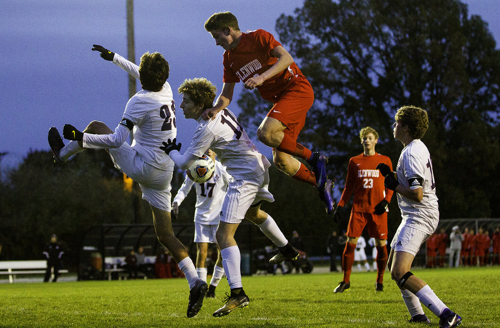 Glenwood's Gay Jett leaps to try and head the ball in between two Waterloo Gibault defenders during the University of Illinois Springfield Supersectional at Kiwanis Stadium Tuesday, Oct. 31, 2017.  [Ted Schurter/The State Journal-Register]