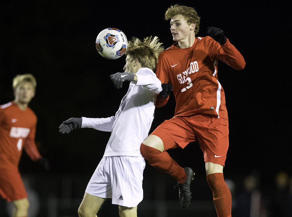 Waterloo Gibault's Karson Huels and Glenwood's Alek Votava collide during the University of Illinois Springfield Supersectional at Kiwanis Stadium Tuesday, Oct. 31, 2017.  [Ted Schurter/The State Journal-Register]