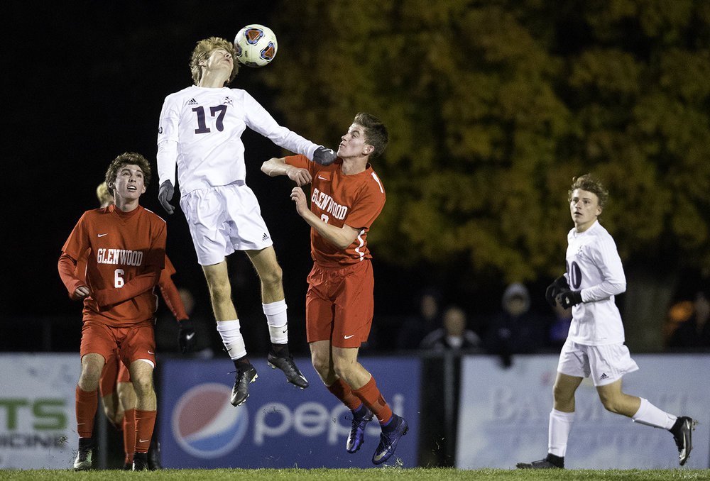 Waterloo Gibault's Logan Doerr heads the ball in front of Glenwood's Gay Jett during the University of Illinois Springfield Supersectional at Kiwanis Stadium Tuesday, Oct. 31, 2017.  [Ted Schurter/The State Journal-Register]