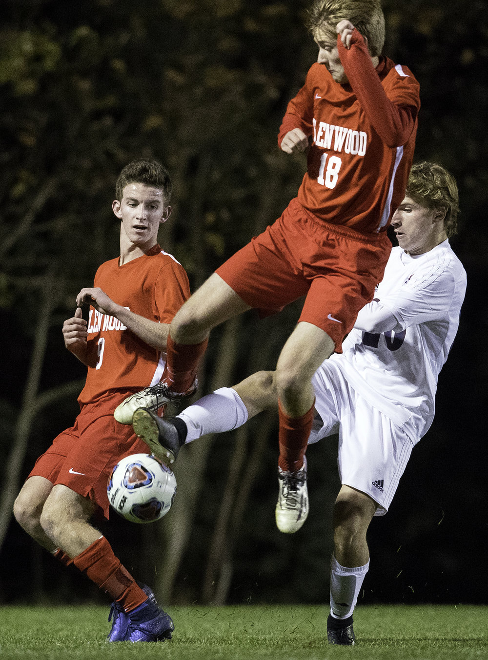 Waterloo Gibault's Adam Stearns kicks the ball upfield as Glenwood's Ethan Childress defends during the University of Illinois Springfield Supersectional at Kiwanis Stadium Tuesday, Oct. 31, 2017.  [Ted Schurter/The State Journal-Register]