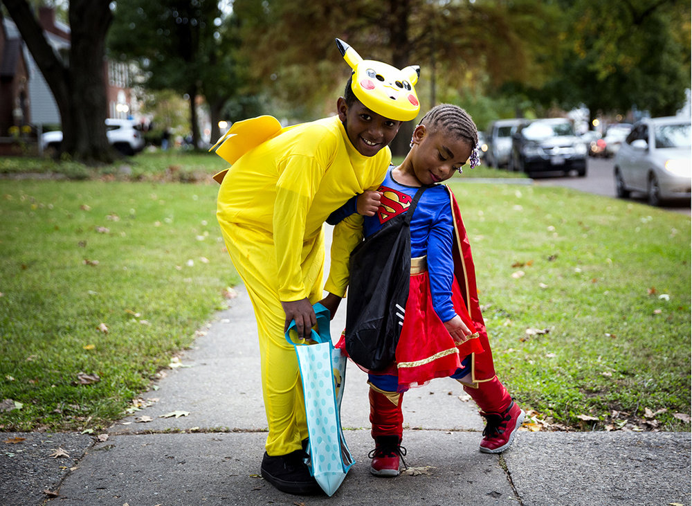Eason Ross, Pokemon, and his cousin, Anyla Nathan, Super Woman, pose for a photo while trick or treating on South Glenwood Avenue Tuesday, Oct. 31, 2017. [Rich Saal/The State Journal-Register]