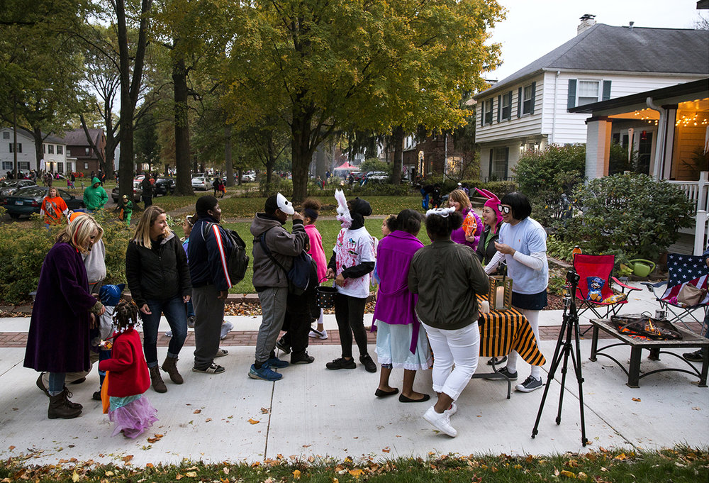Rod and Kelly Lane hand out treats from their driveway during Halloween in the South Glenwood Avenue neighborhood Tuesday, Oct. 31, 2017. [Rich Saal/The State Journal-Register]