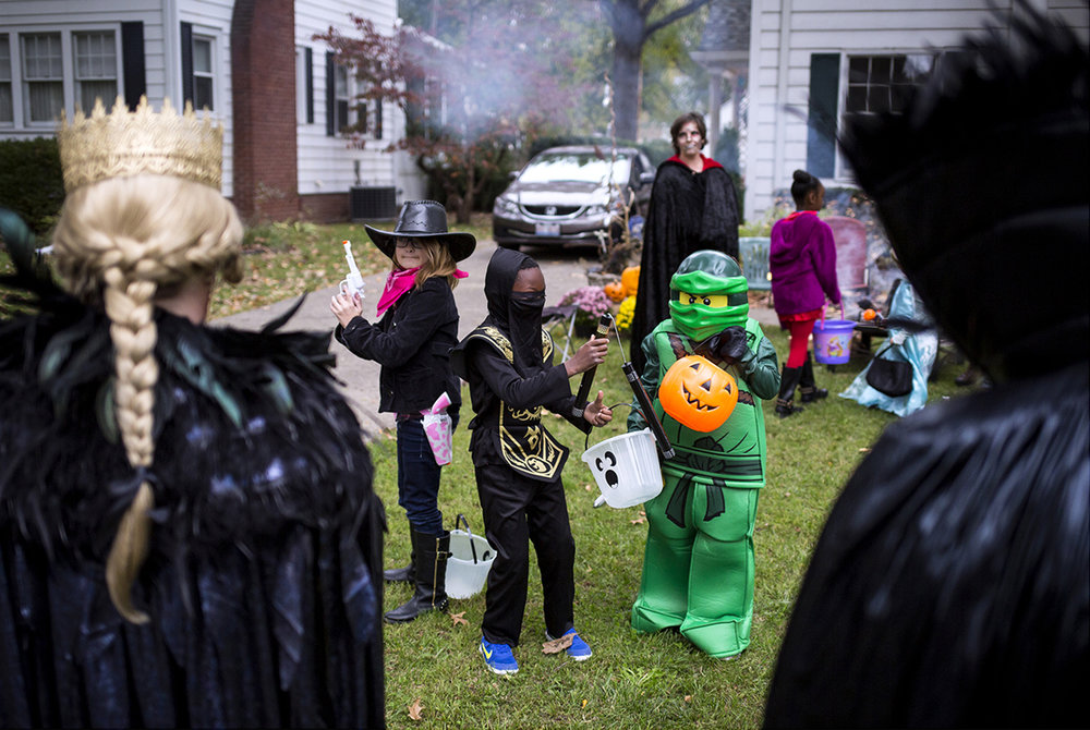 Chloe and Dominick Stampehl, and Lucien Lesniak pose for pictures before heading out to trick or treat in the neighborhood on South Glenwood Avenue Tuesday, Oct. 31, 2017. [Rich Saal/The State Journal-Register]