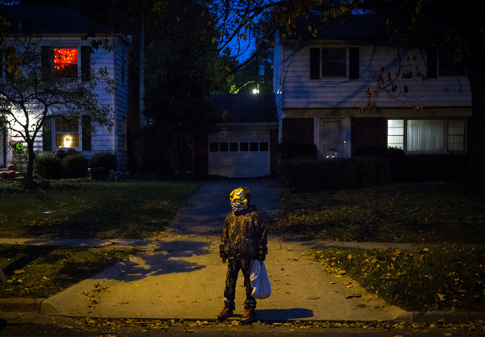 A mask-wearing trick or treater waits to cross the street on South Glenwood Avenue Tuesday, Oct. 31, 2017. [Rich Saal/The State Journal-Register]