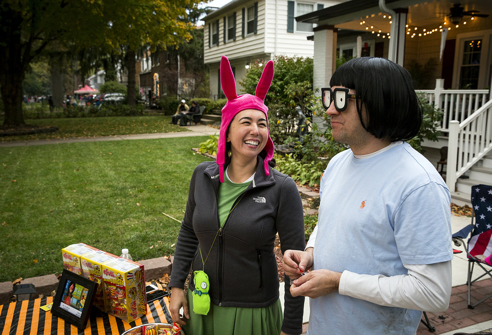 Kelly and Rod Lane, who dressed as Louise and Tina from the animated sitcom on cable television, Bob's Burgers, distributed eFrutti mini burger gummy candy from their driveway on South Glenwood Avenue Tuesday, Oct. 31, 2017. [Rich Saal/The State Journal-Register]