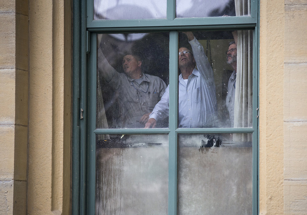Secretary of State building services staff try to open the window where a small fire broke out on the first floor of the Capitol Tuesday, Oct. 24, 2017. The fire was extinguished quickly and no injuries were reported but the building was evacuated. [Rich Saal/The State Journal-Register]