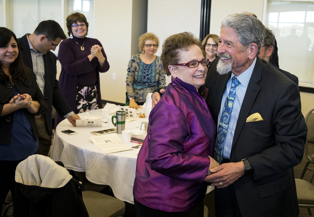 Lisa Stone was named The State Journal-Register's 2017 First Citizen Thursday, Oct. 26, 2018 during a ceremony at Erin's Pavilion. She was congratulated by her husband, Stephen. [Rich Saal/The State Journal-Register]