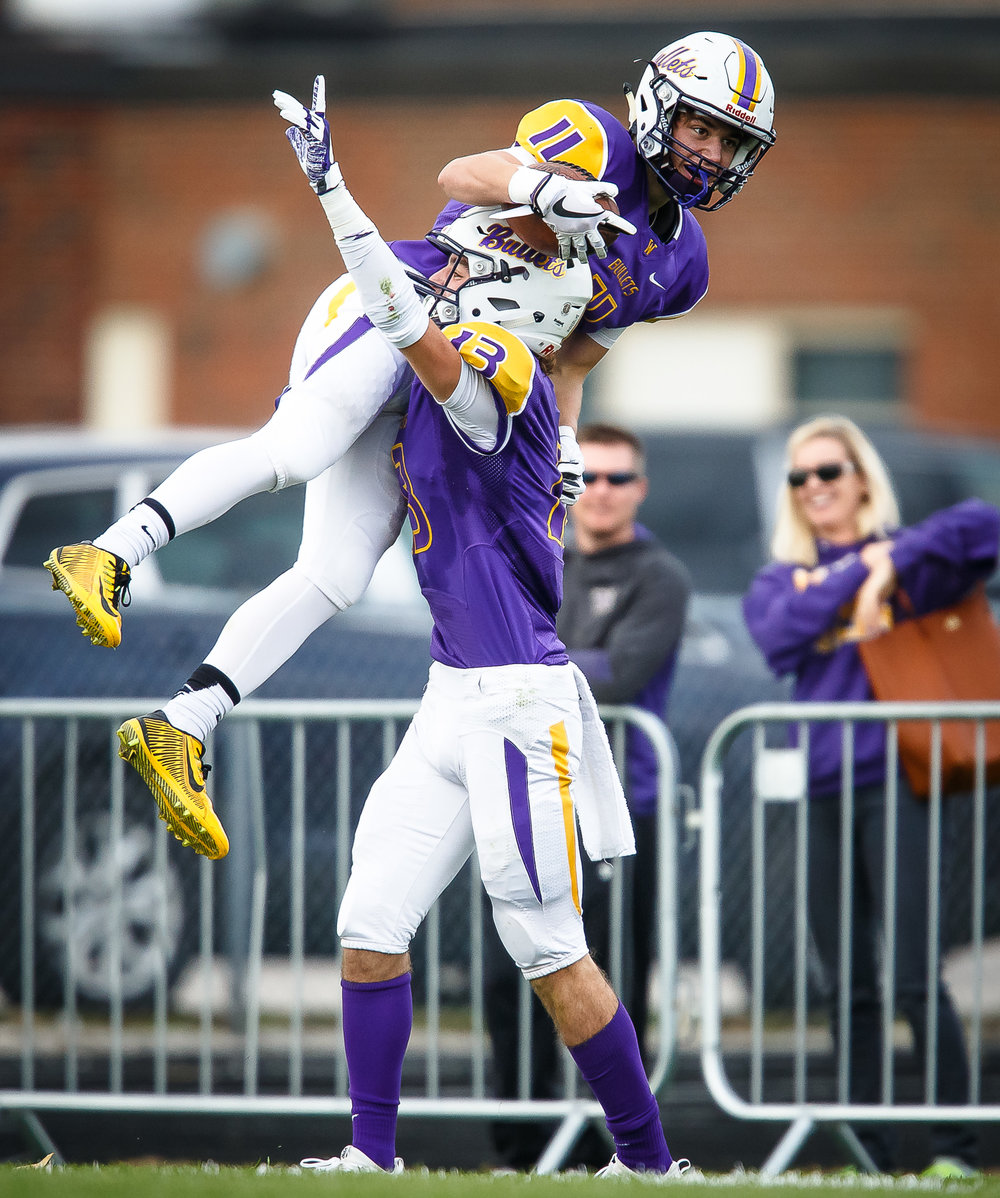 Williamsville's Hunter Thompson (11) is hoisted up by Williamsville's Joseph Mitchell (13) after his 78-yard touchdown catch against Bloomington Central Catholic in the third quarter during the second round of the IHSA Class 3A Playoffs at Paul Jenkins Field, Saturday, Nov. 4, 2017, in Williamsville, Ill. [Justin L. Fowler/The State Journal-Register]