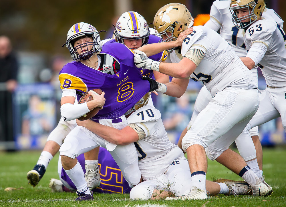 Williamsville's Justice Ferrier (8) is drug down by Bloomington Central Catholic's Joe Malinowski (70) on a rush in the first quarter during the second round of the IHSA Class 3A Playoffs at Paul Jenkins Field, Saturday, Nov. 4, 2017, in Williamsville, Ill. [Justin L. Fowler/The State Journal-Register]